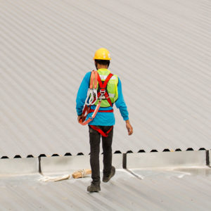 Builder Working on Commercial Roof Repair