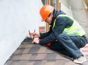 Roofer Working on Repairs of Asphalt Shingle Roof