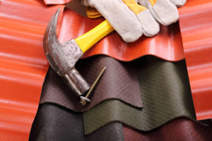Roofing Sheets, a Hammer, and Screws for Repairs