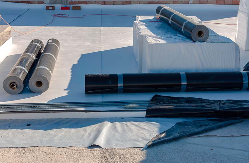 TPO Membrane Rolls. Installation of TPO Roof in Commercial Building